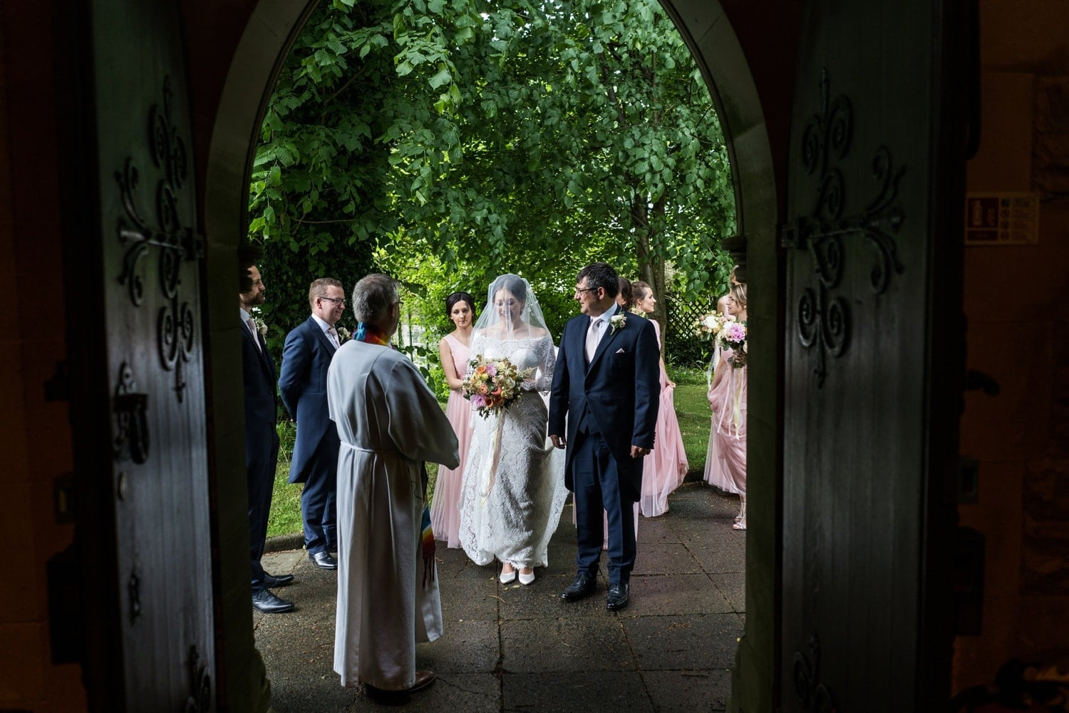 bride arrives at St David's Church in Miskin, South Wales