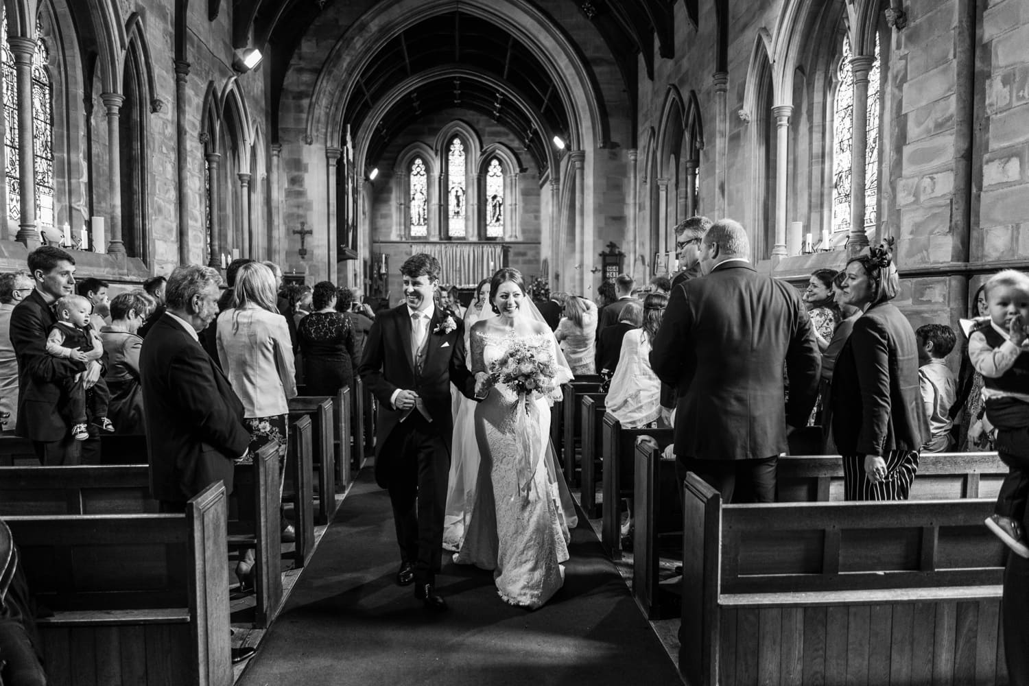 bride & groom walking down aisle at St David's Church in Miskin, South Wales