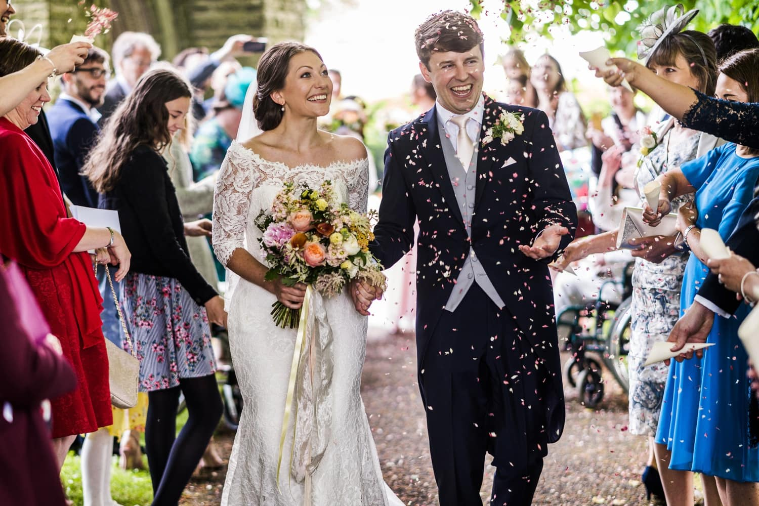 guests throw confetti at newly married couple at Miskin in South Wales