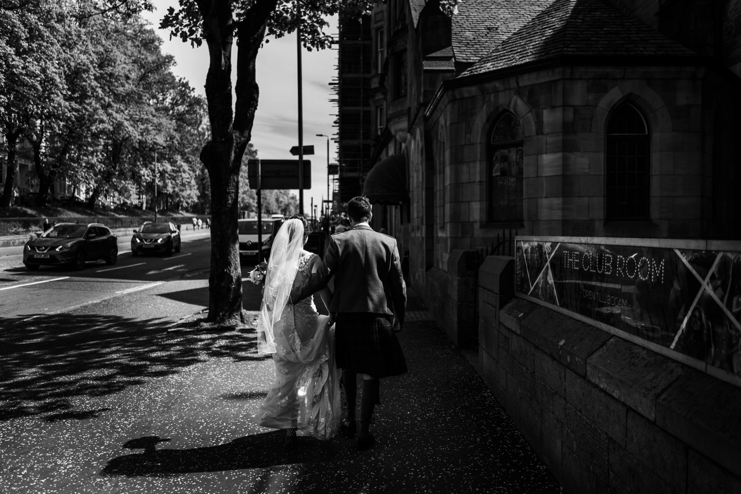 Bride and groom on streets of Glasgow in Scotland