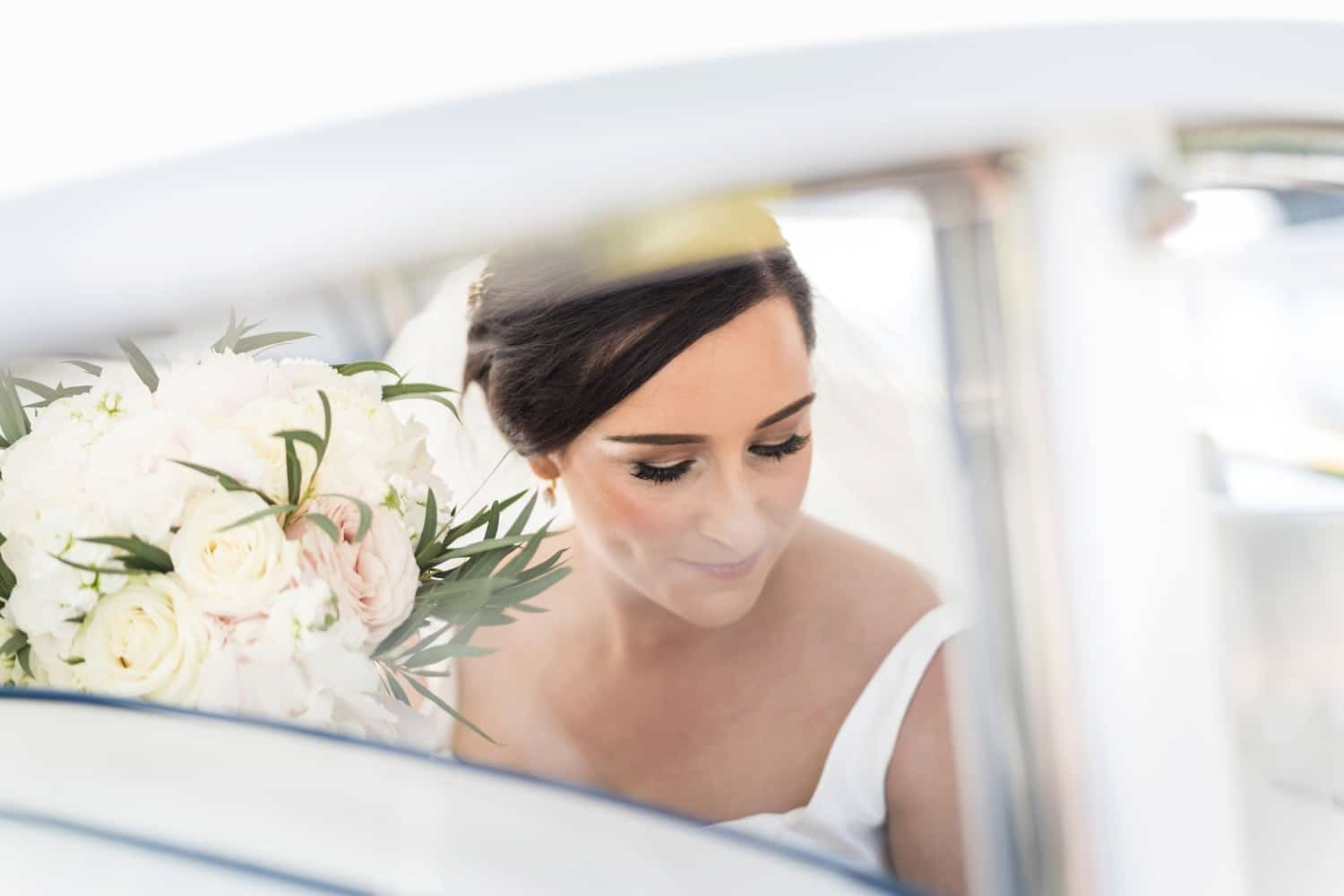 Bride arrives in car at St Isaan's Church in Llanishen, Cardiff