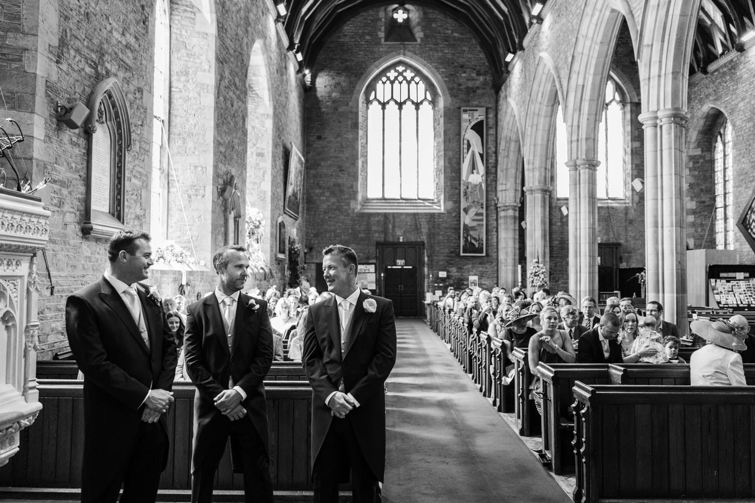 Groom waits at St Marys Church in Abergavenny in South Wales