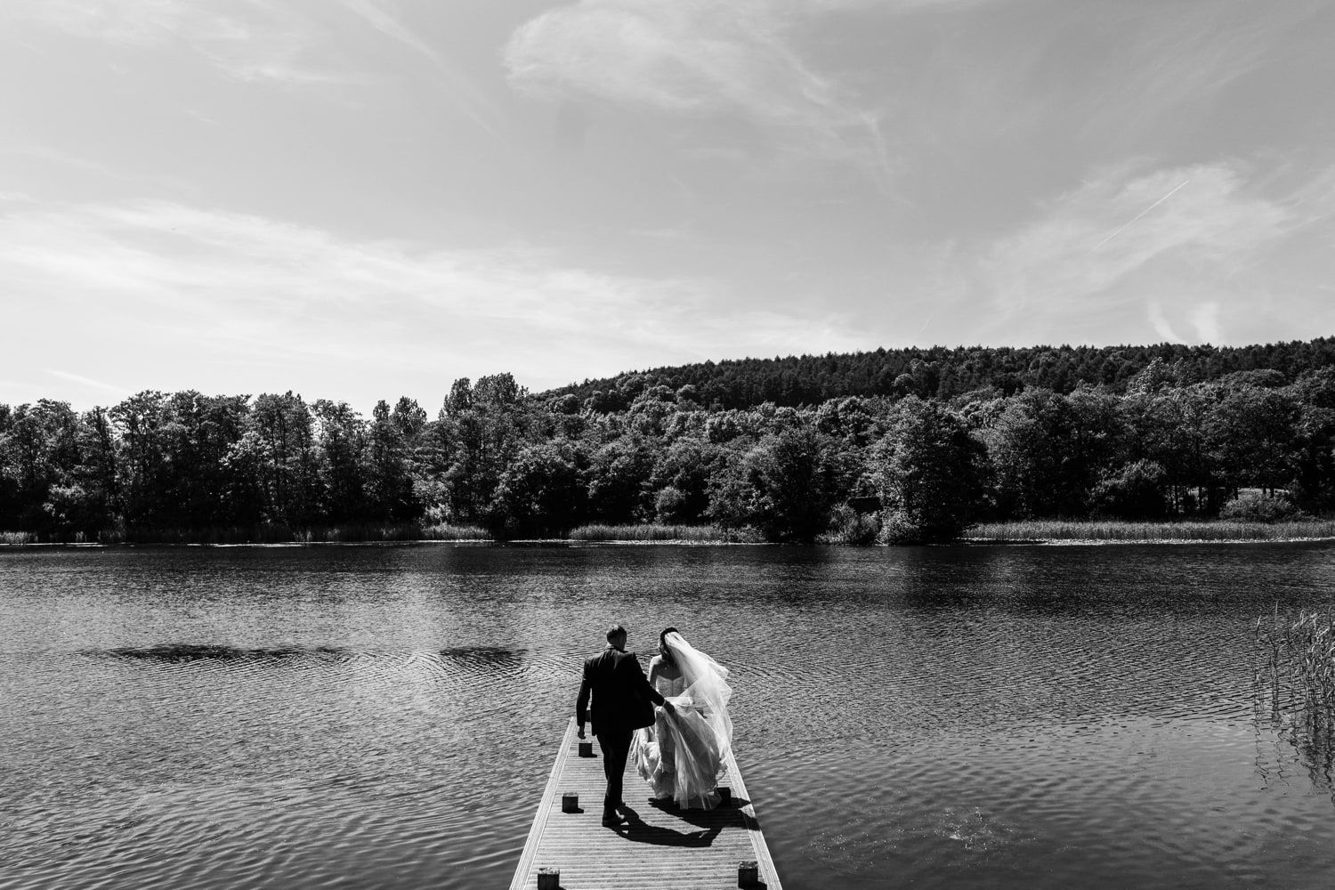 Bride and groom on jetty at Hensol Castle wedding