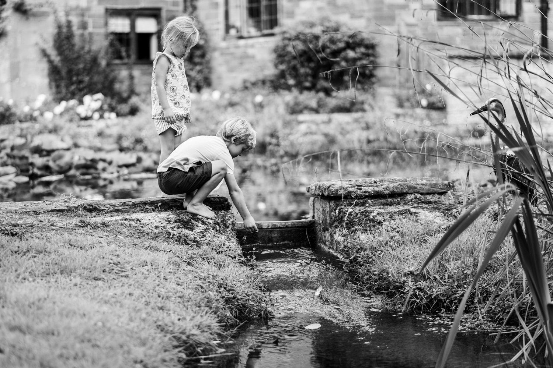 Boy playing in the stream at Brinsop Court wedding