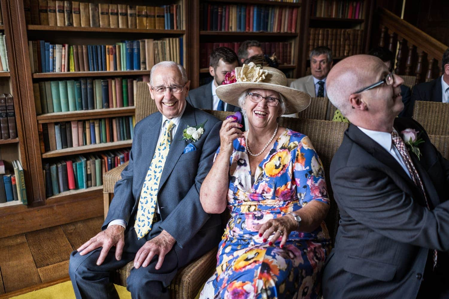 Grooms parents with electric fan at a Brinsop Court wedding