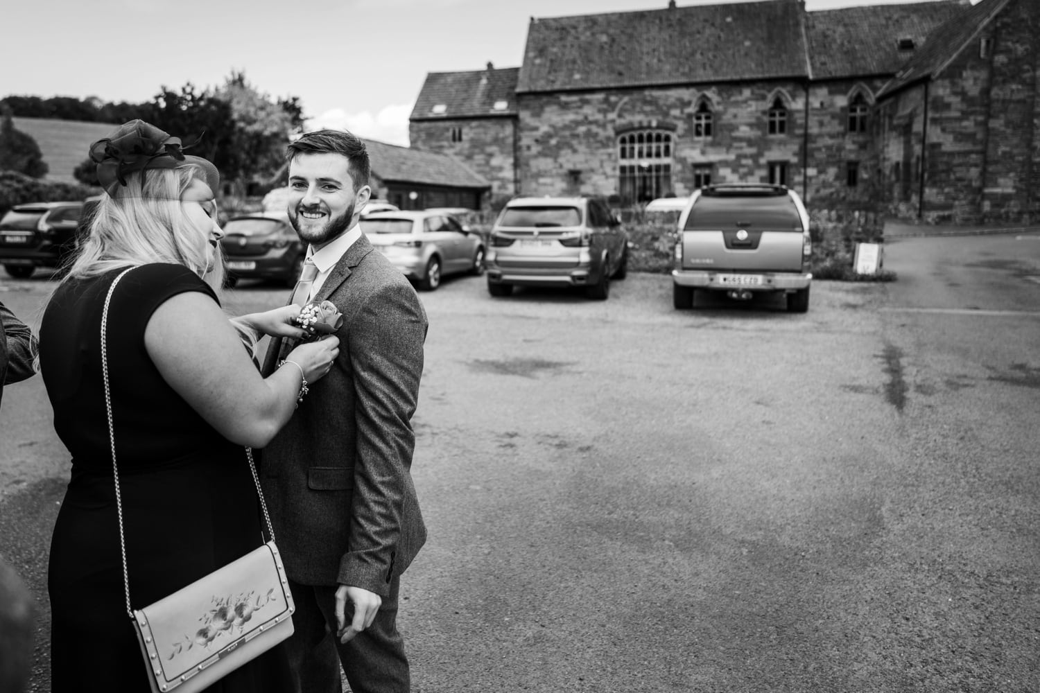 Groom arrives at Herefordshire wedding venue Flanesford Priory