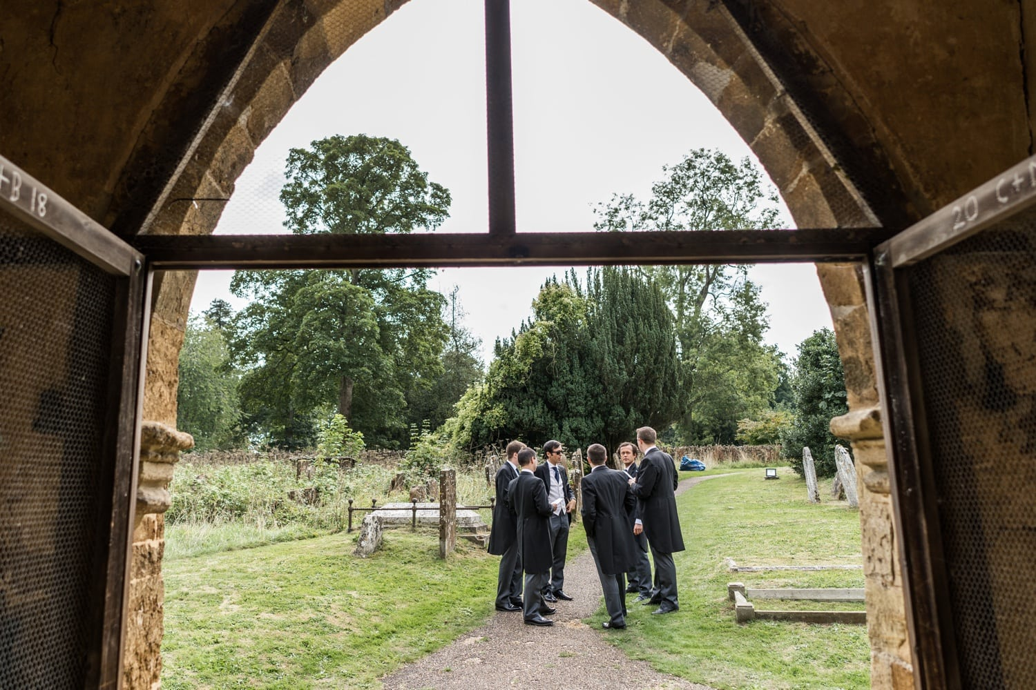 Groom and ushers at Great Tew church for a Cotswold wedding
