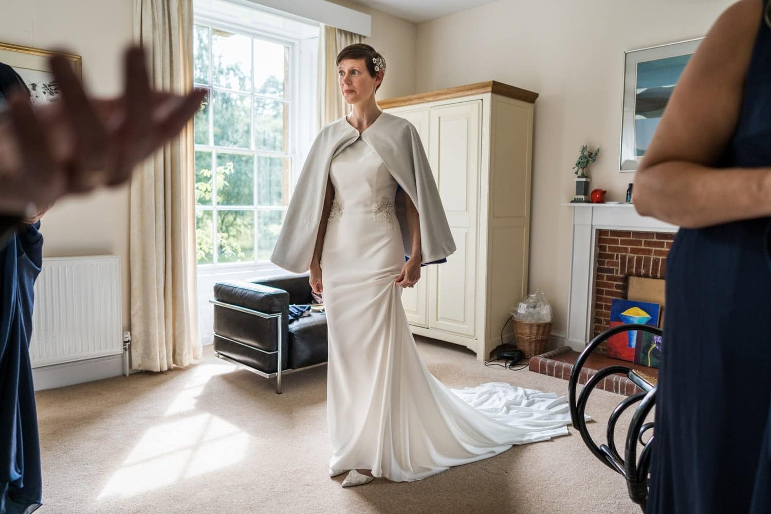 Bride with dress at a Cotswold wedding at Soho Farmhouse