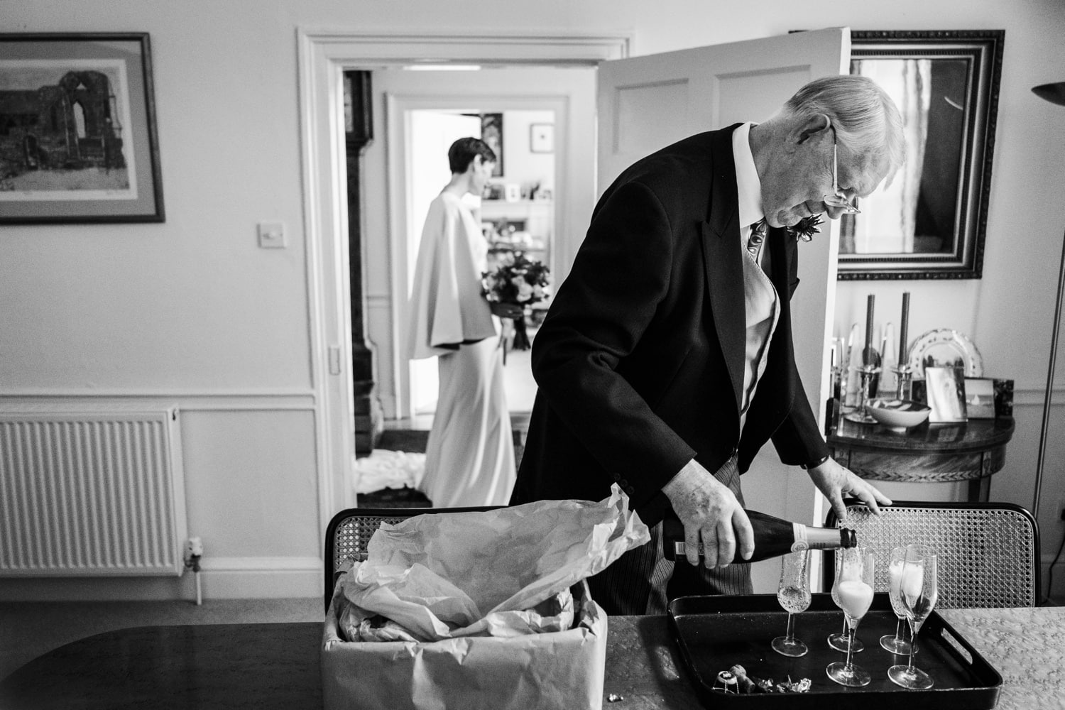 Bride's Dad pours champagne for a Cotswold wedding at Soho Farmhouse