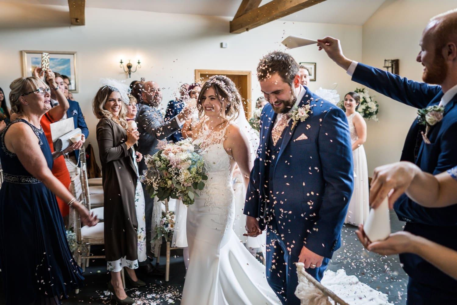 Bride and groom with confetti at South Wales wedding at Ocean View