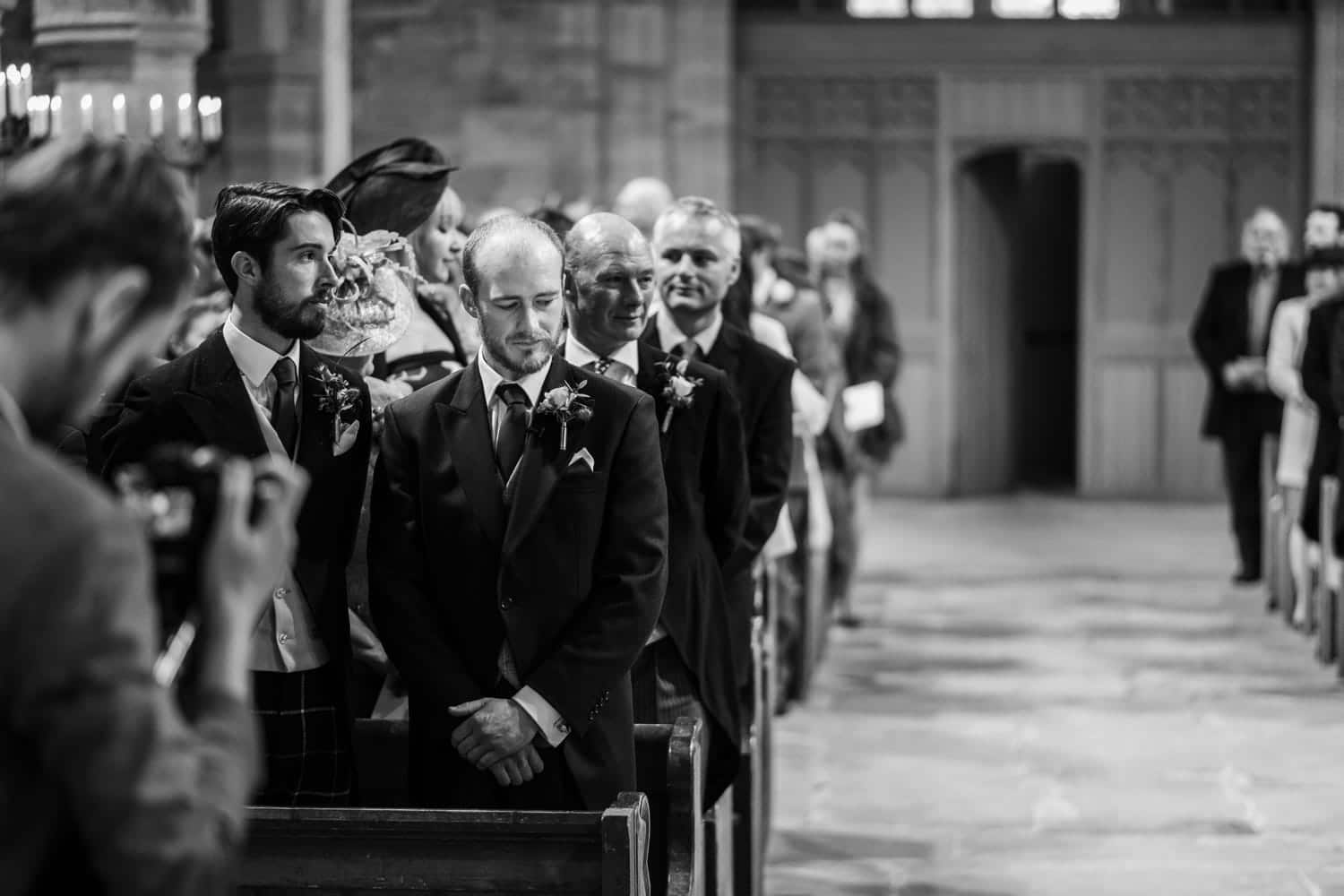 Groom waits for bride at church