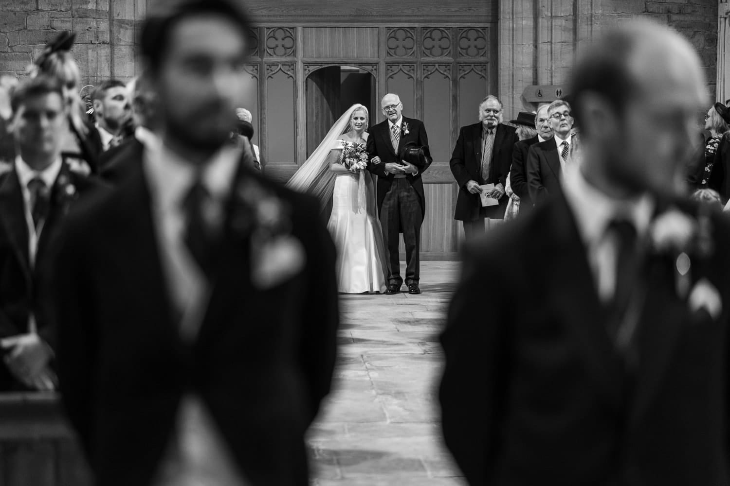 Bride walks up church aisle with father