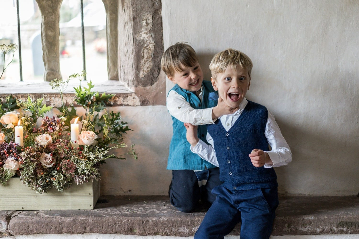 Boys messing about in church wedding in Monmouthshire