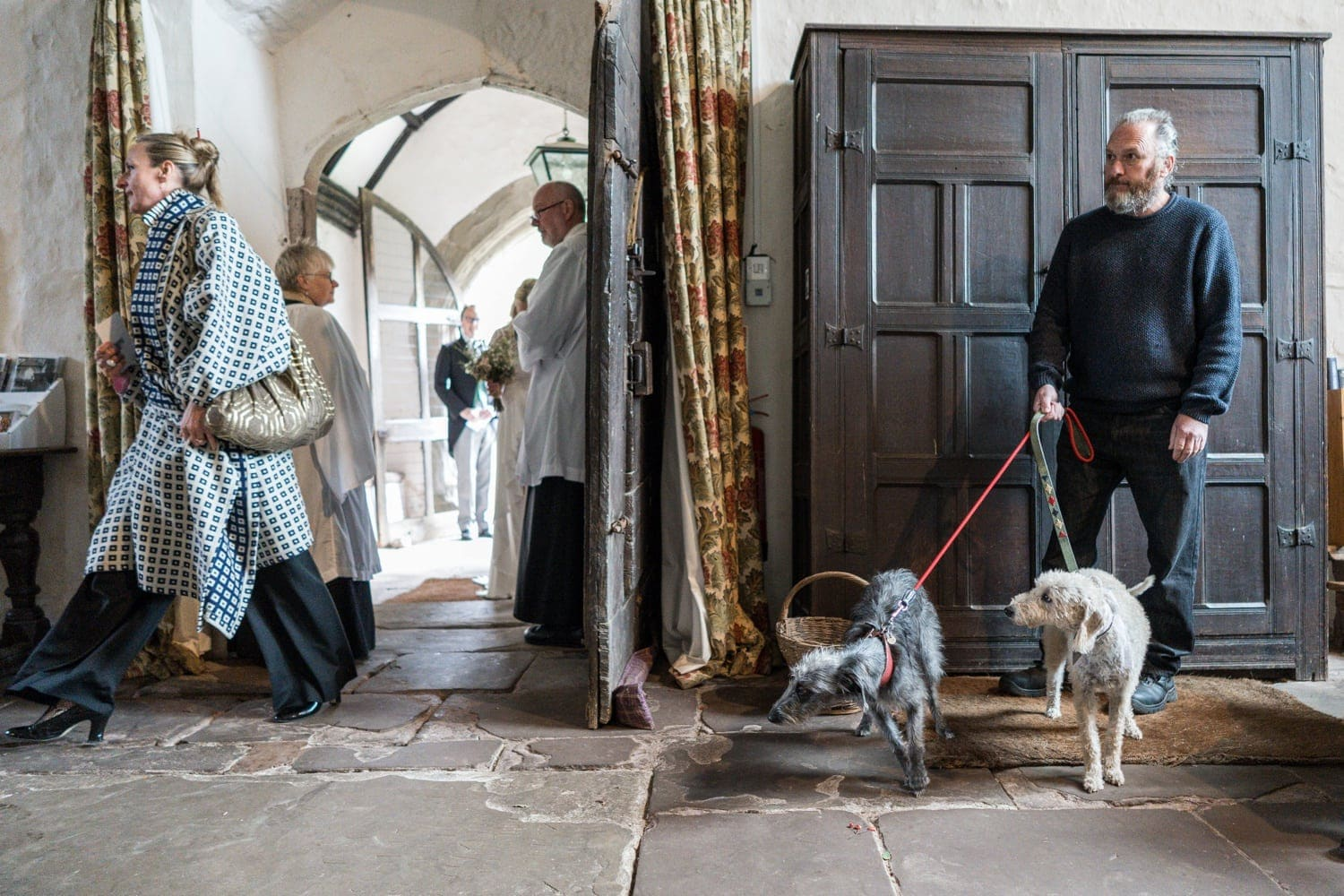 Man holding dogs in Monmouthshire church wedding