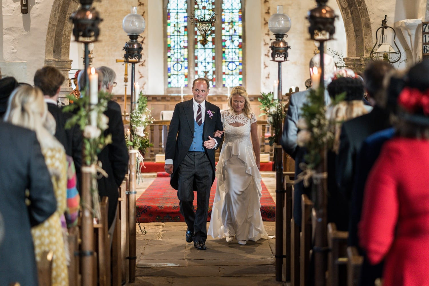 Bride and groom walking down aisle at St Brigit's Church, Skenfrith, Monmouthshire