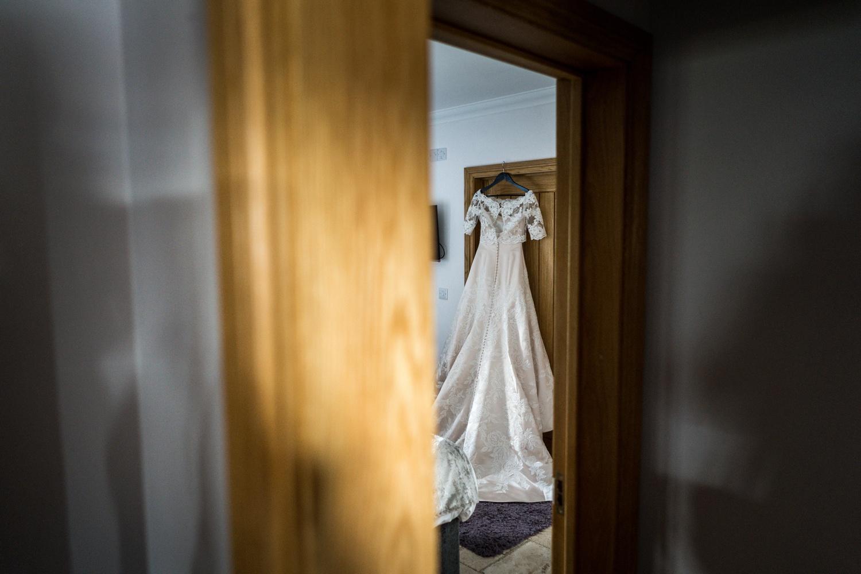 Wedding dress hanging up at Oldwalls, South Wales