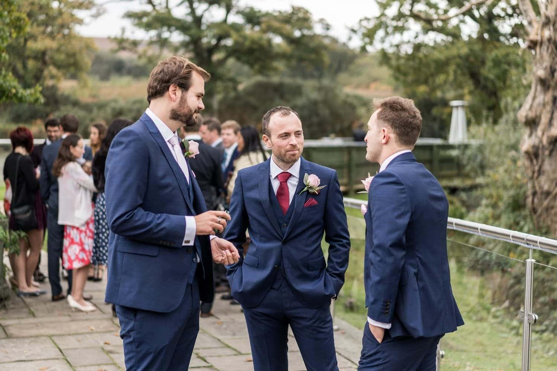 Groom chatting Bridal preparations at Oldwalls, South Wales