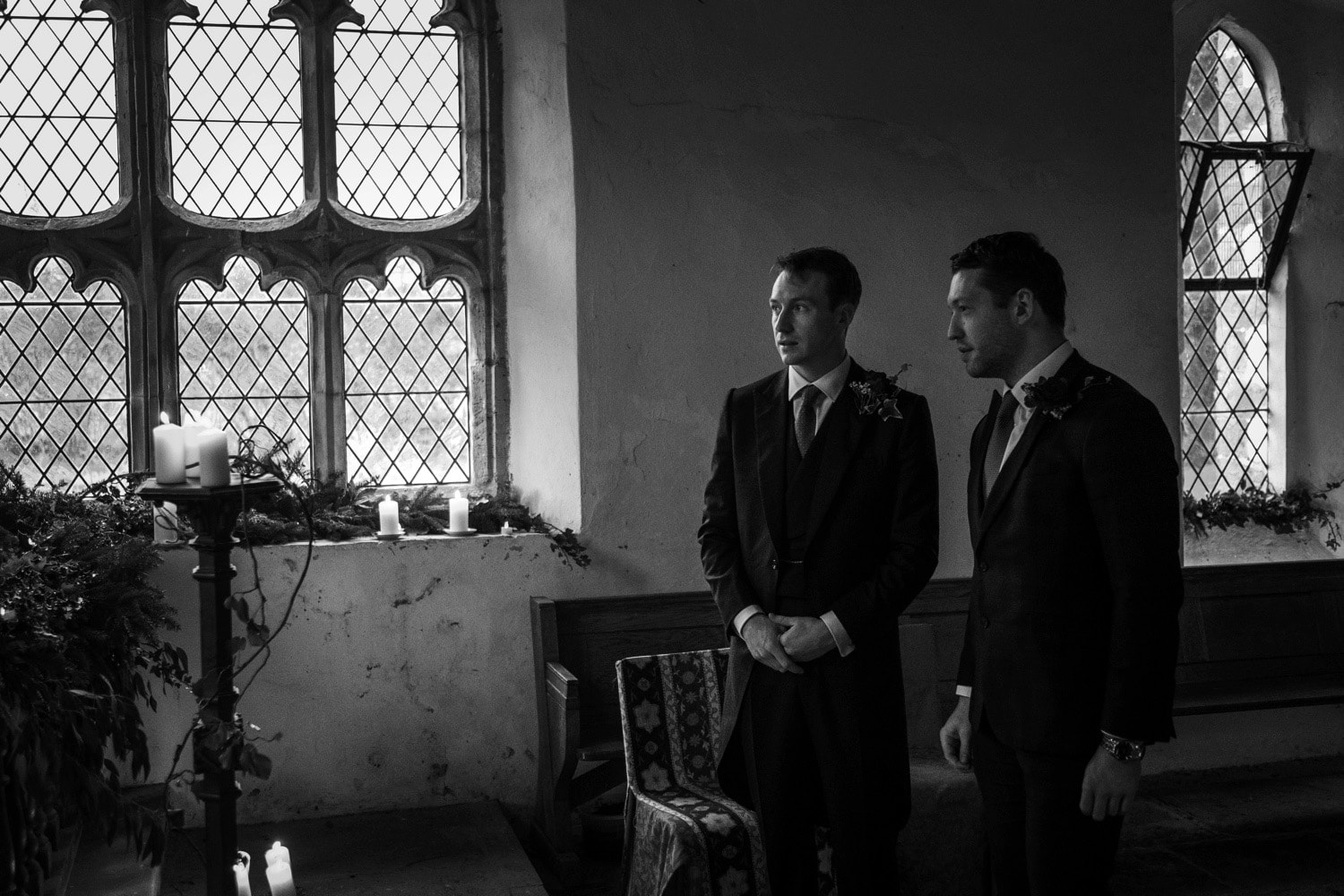 Groom and best man waiting at alter