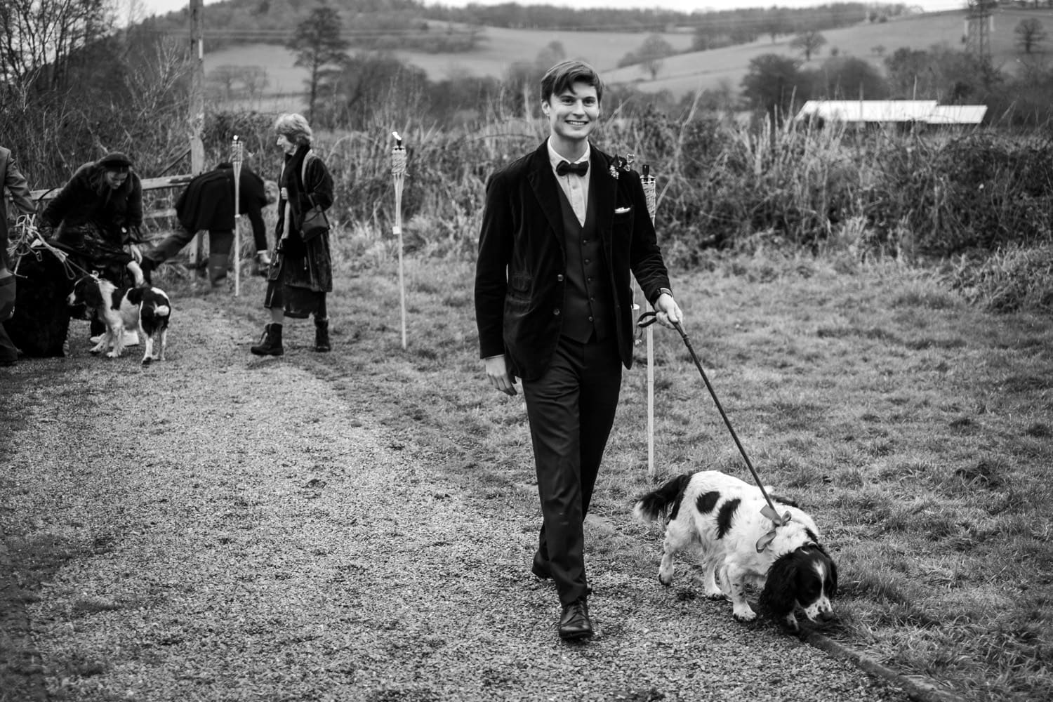 Guest arriving with dogs for church wedding