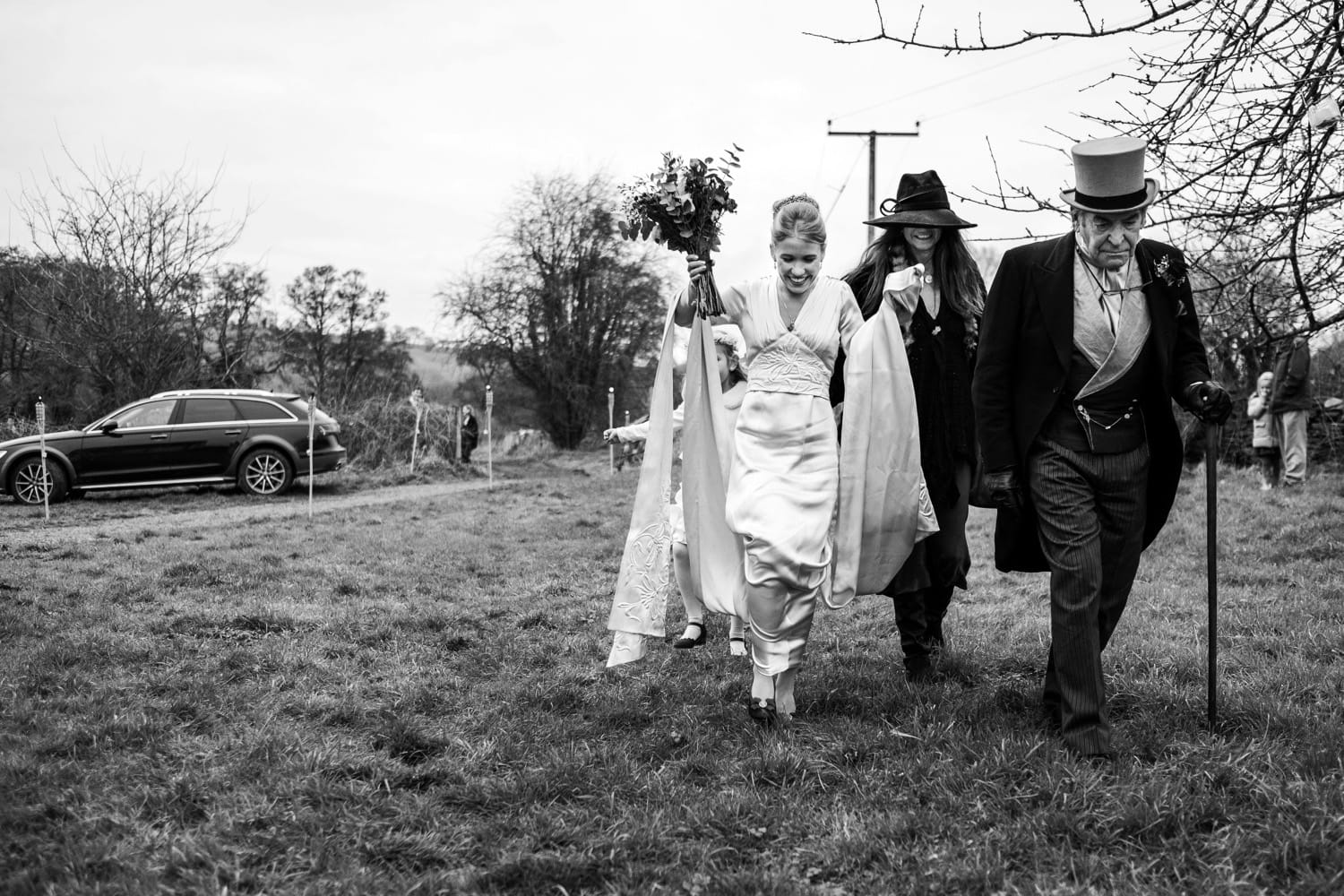 Bride arrives for church wedding in a Monmouthshire field