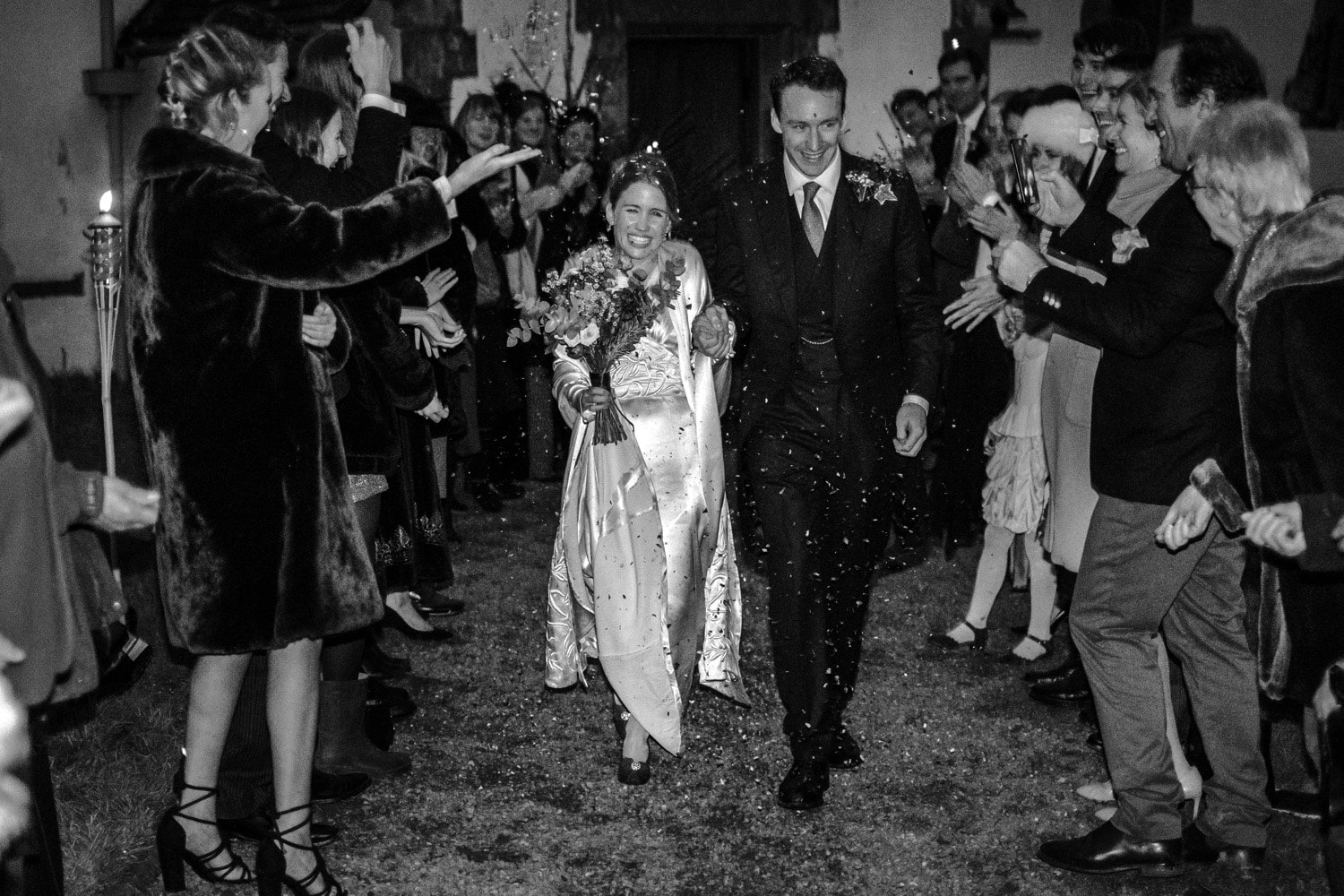 Bride and groom leave church in dark
