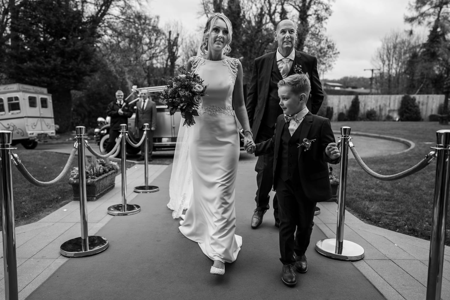 Bride arrives with father and page boy