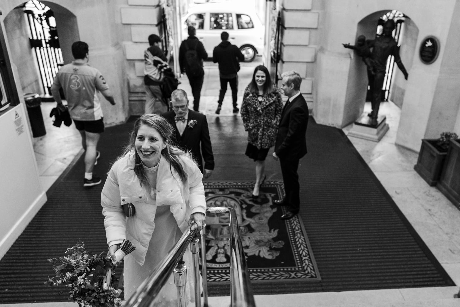 Bride walks up entrance steps at Cardiff City Hall