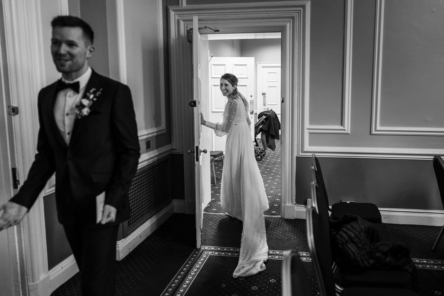 Bride and groom leaving Cardiff City Hall marriage ceremony