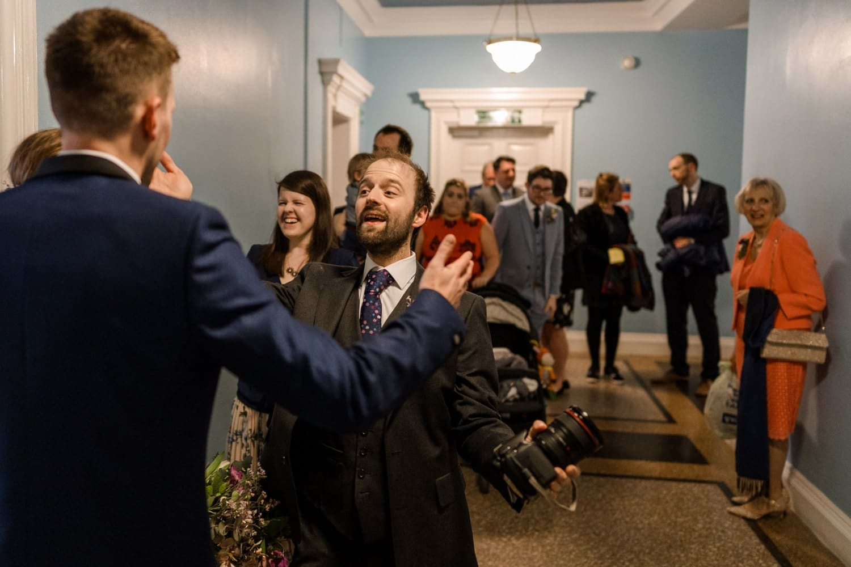 Wedding guest congratulate bride and groom