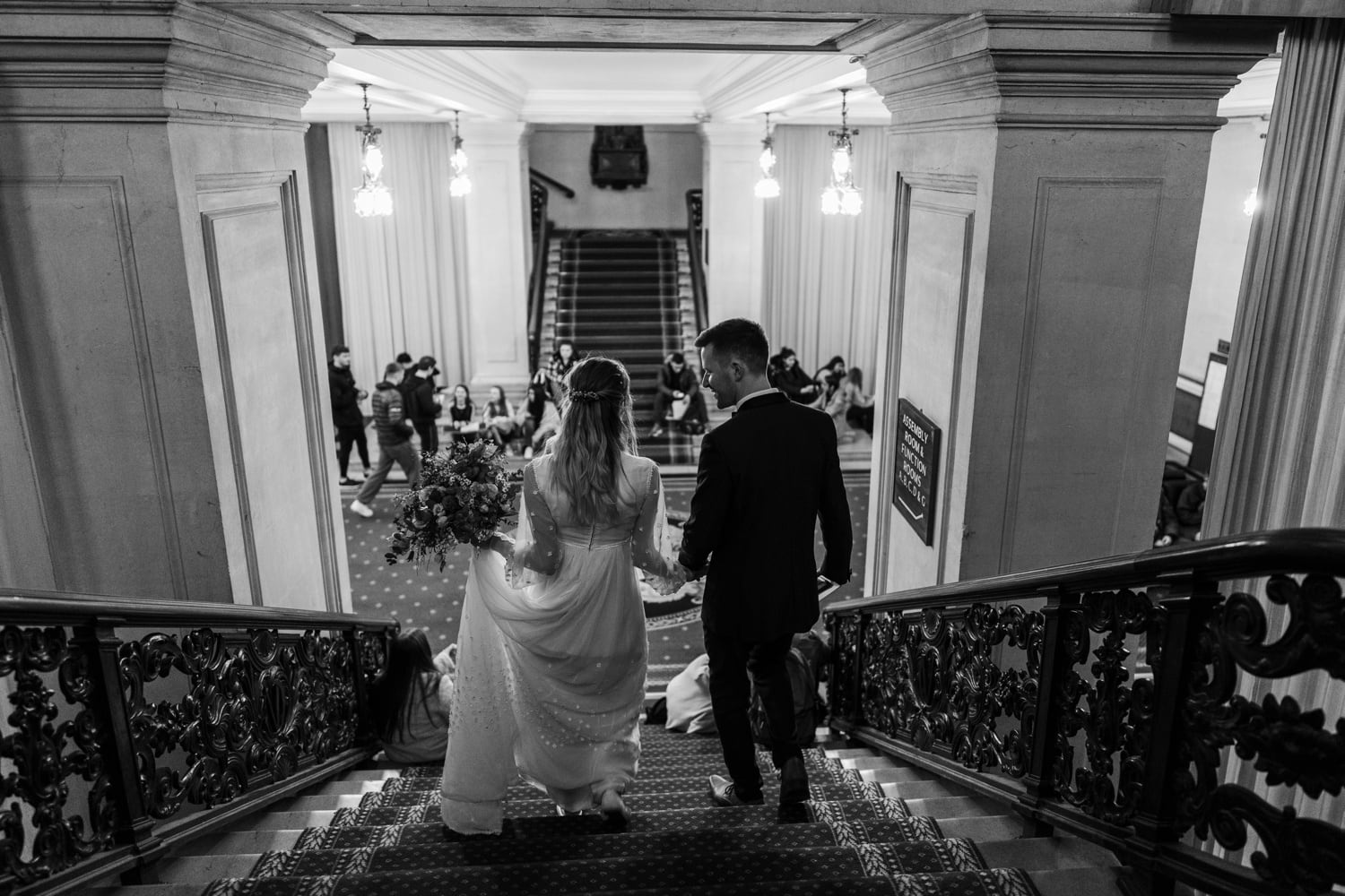 Bride and groom on stairs at Cardiff City Hall