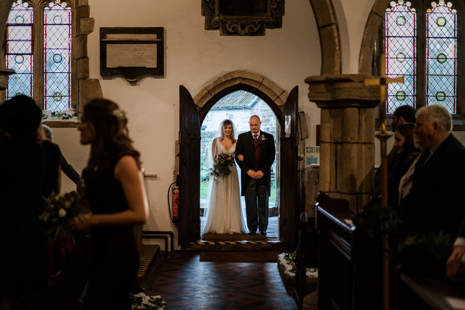 Bride arrives for wedding at St Tewdric's Church in Monmouthshire