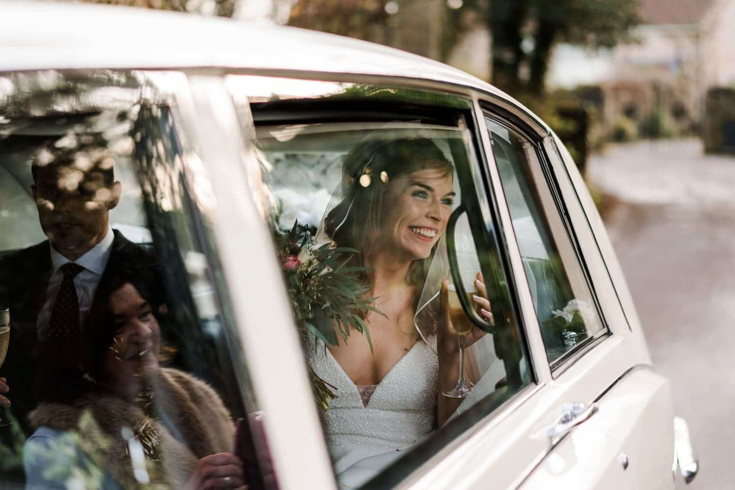 Bride in car at St Tewdric's Church in Monmouthshire