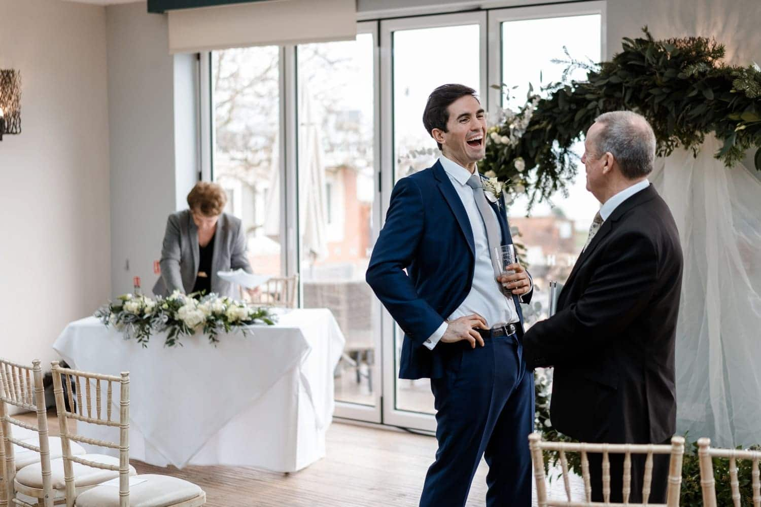 Groom laughing at a Holm House wedding in South Wales