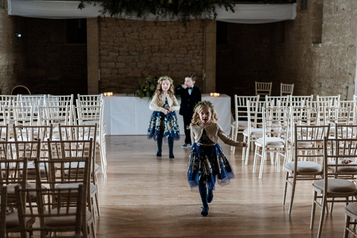Flower girl running down aisle