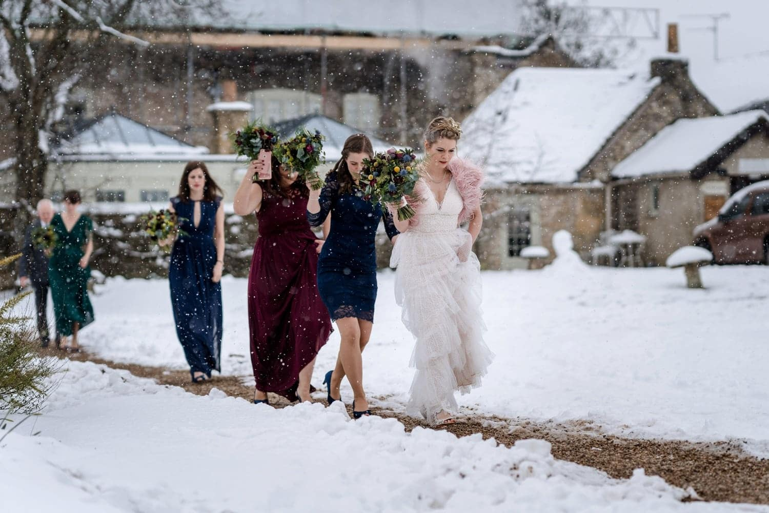 Bride walking through snow