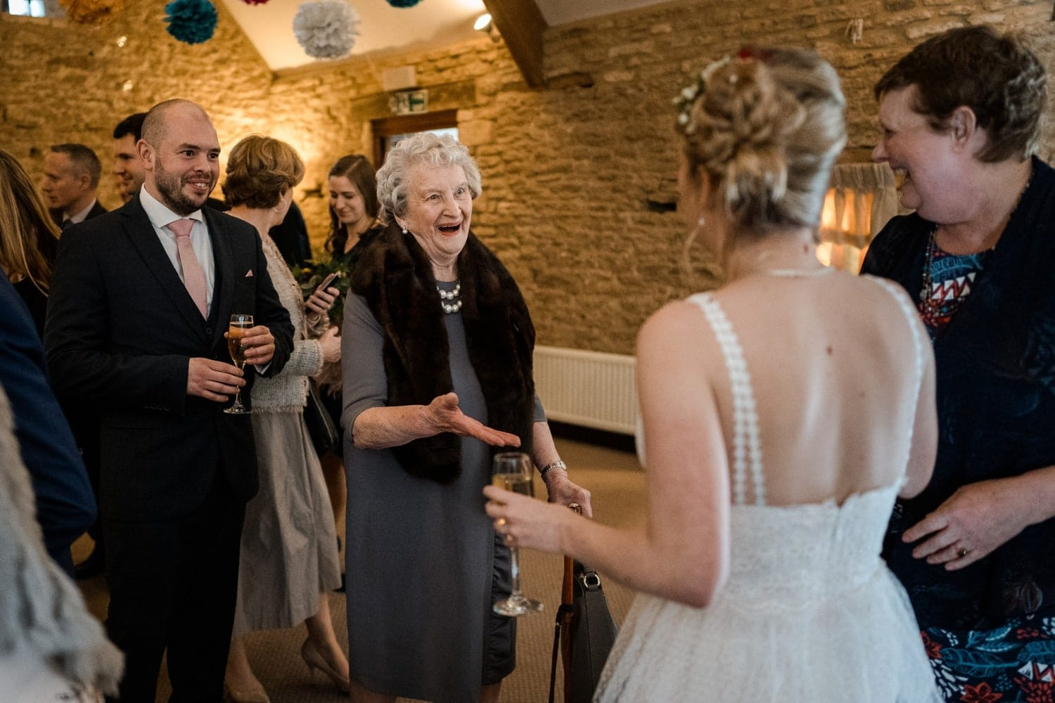 Wedding guests congratulate bride