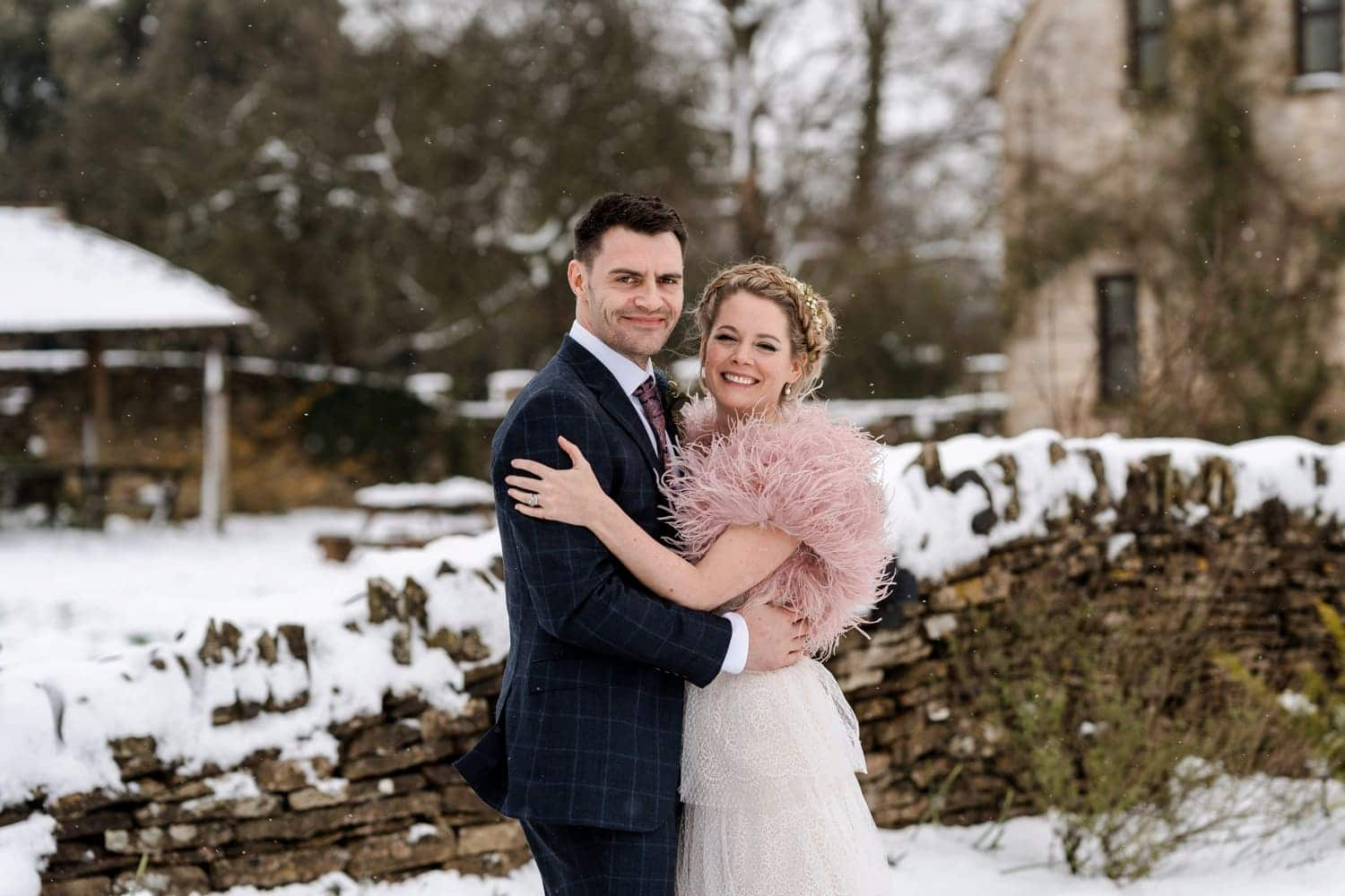 Wedding portraits in the snow at Great Tythe Barn
