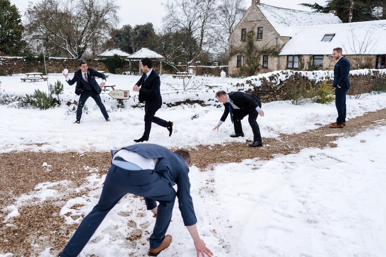 Wedding guest having snow ball fight