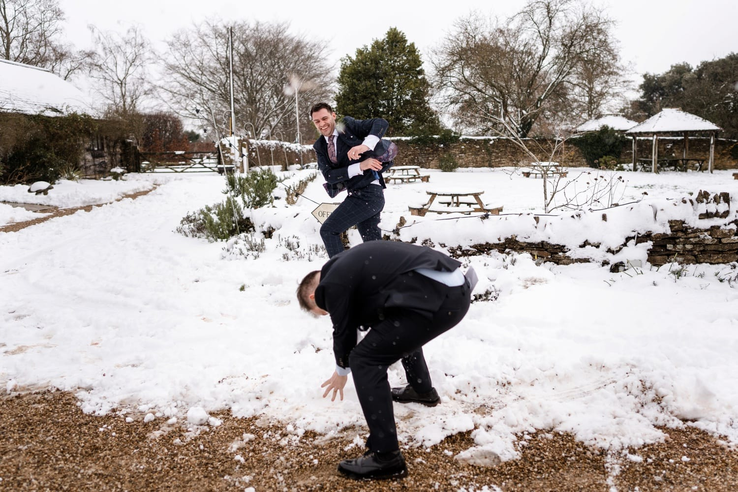 Wedding guest having snow ball fight