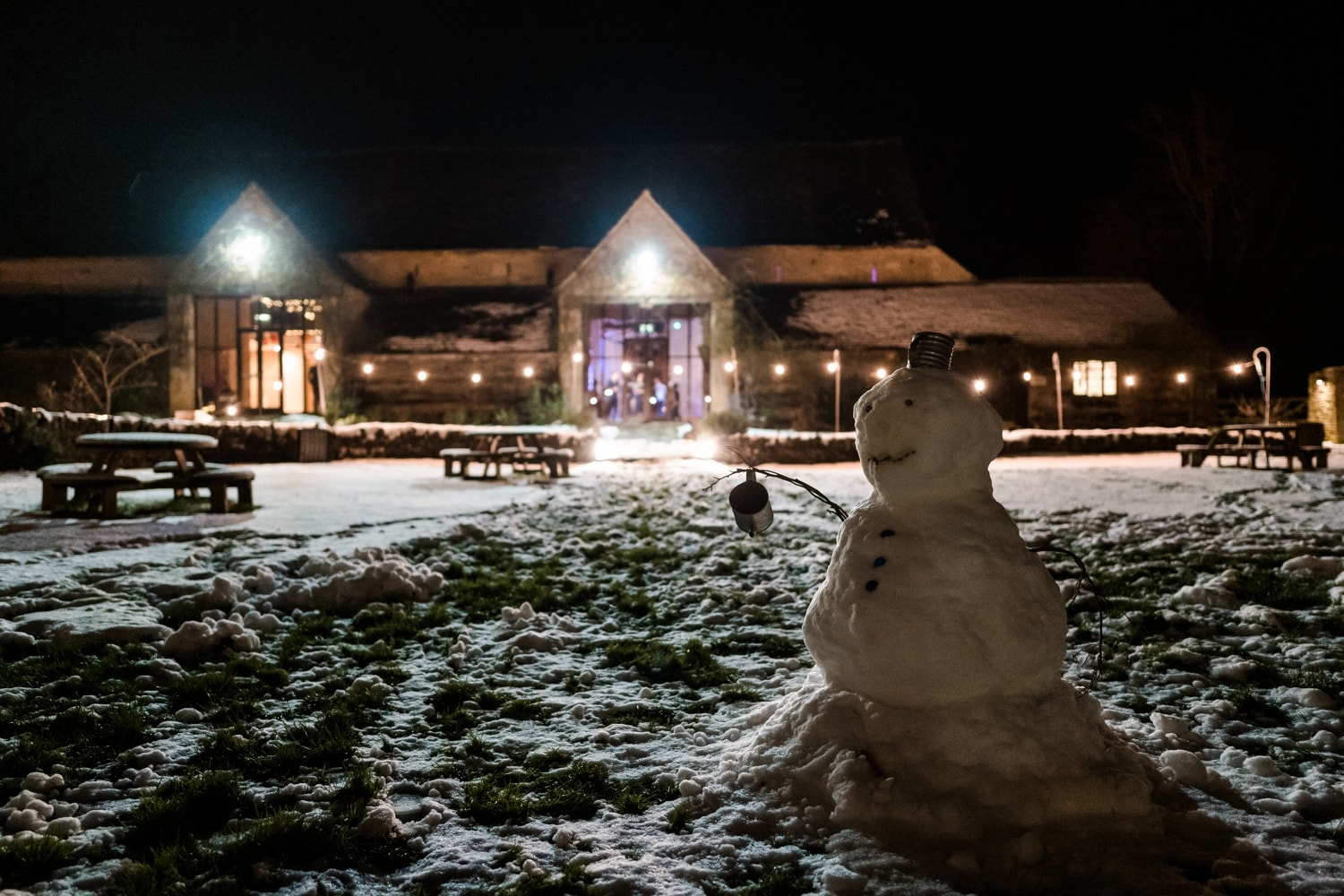 Snowman outside wedding reception at Great Tythe Barn in Tetbury