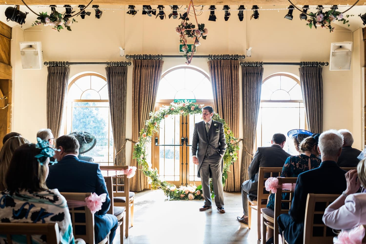 Groom waiting for bride at King Arthur Hotel in Gower, South Wales
