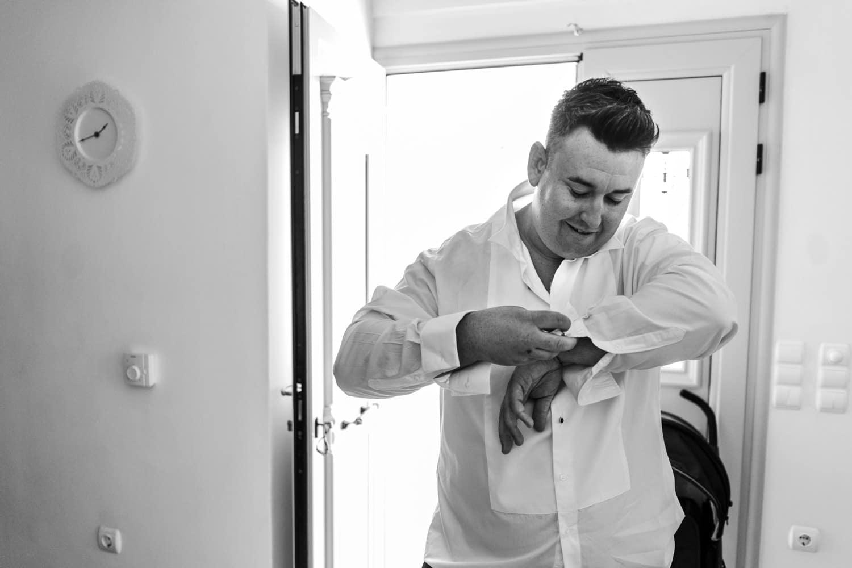 Santorini Wedding Photography, groom putting on cufflinks