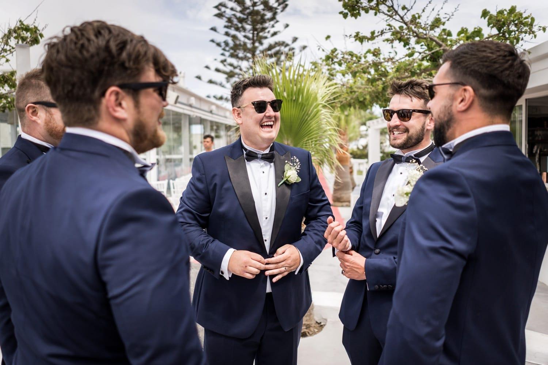 Santorini Wedding Photography, groom laughing at Gem Villa