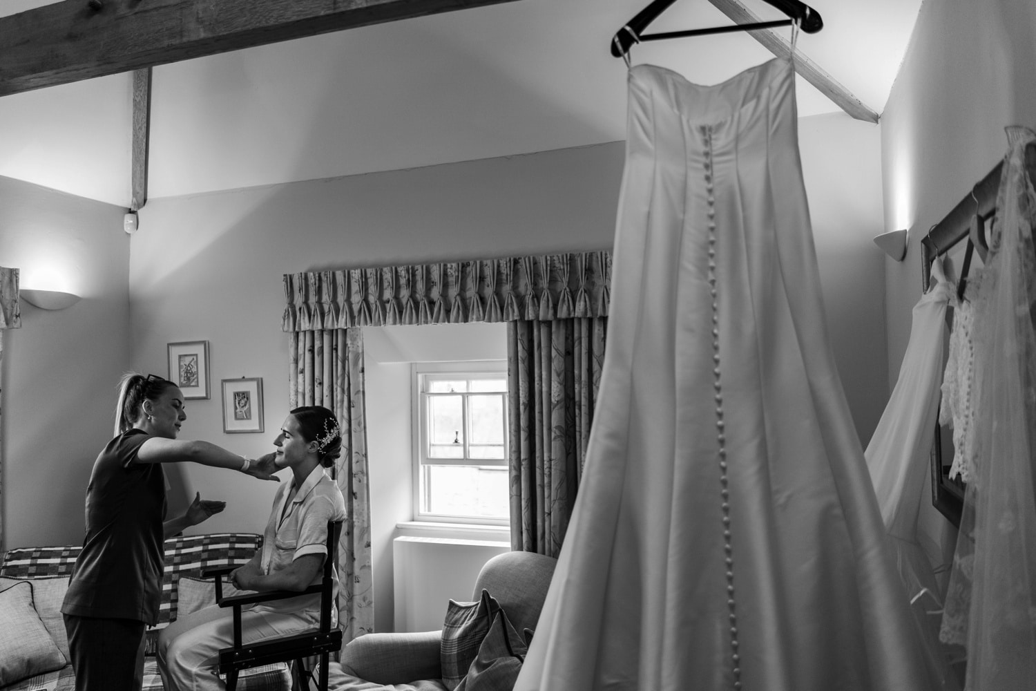 Bride having make up with dress hanging up at Cardigan Castle