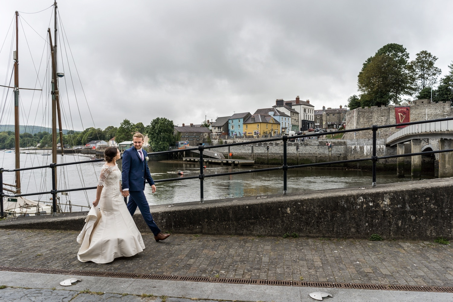 Bride and groom next to River Teifi at Cardigan Castle