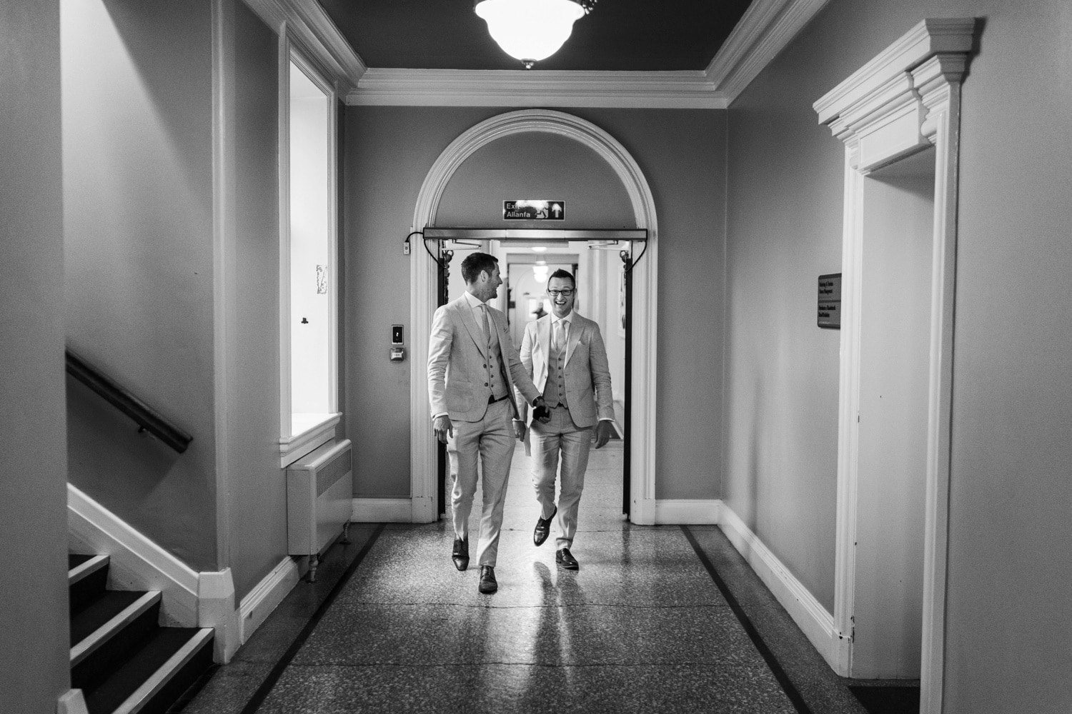 Groom walking with best man at Cardiff City Hall