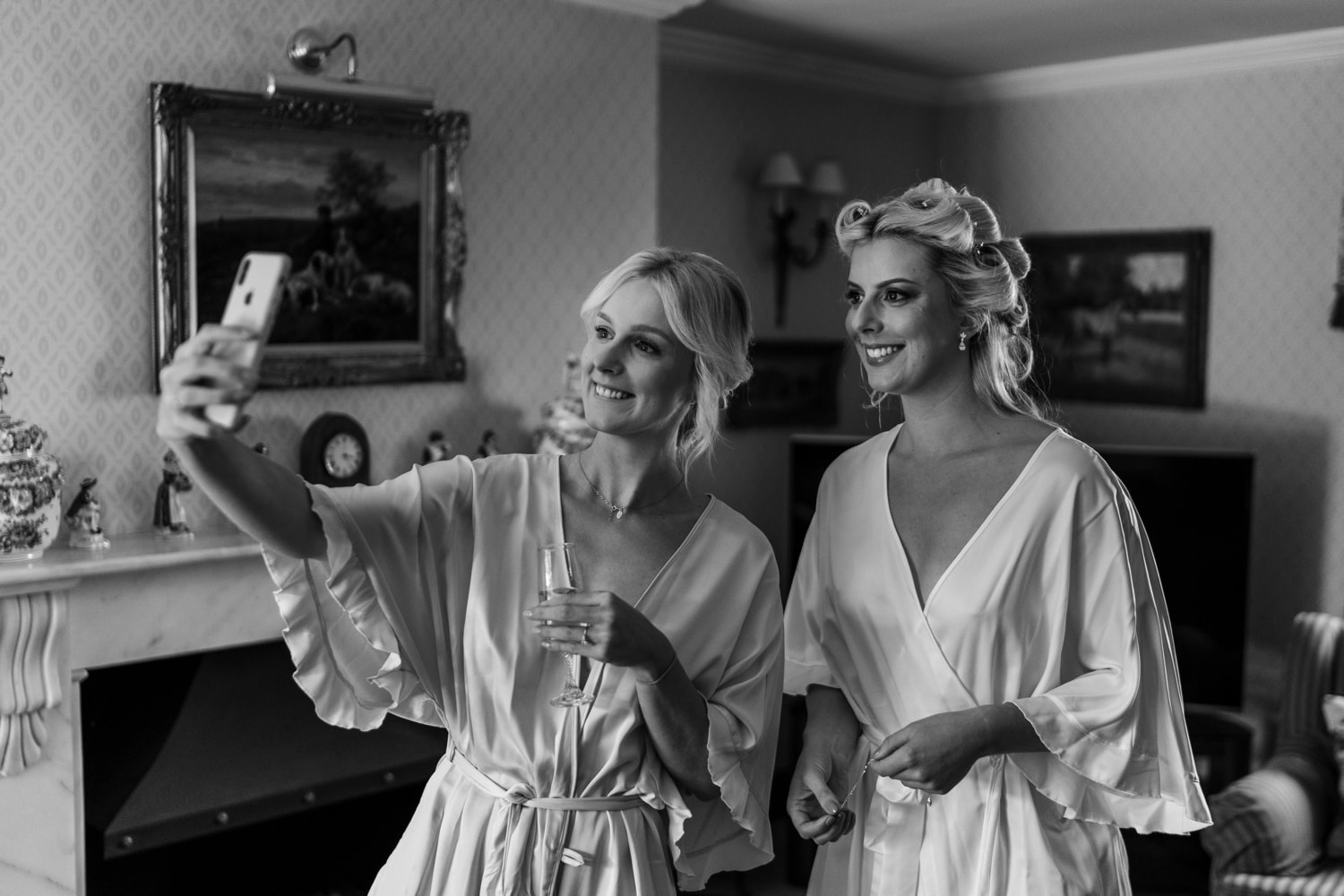 Bride and bridesmaid selfie in dressing gowns
