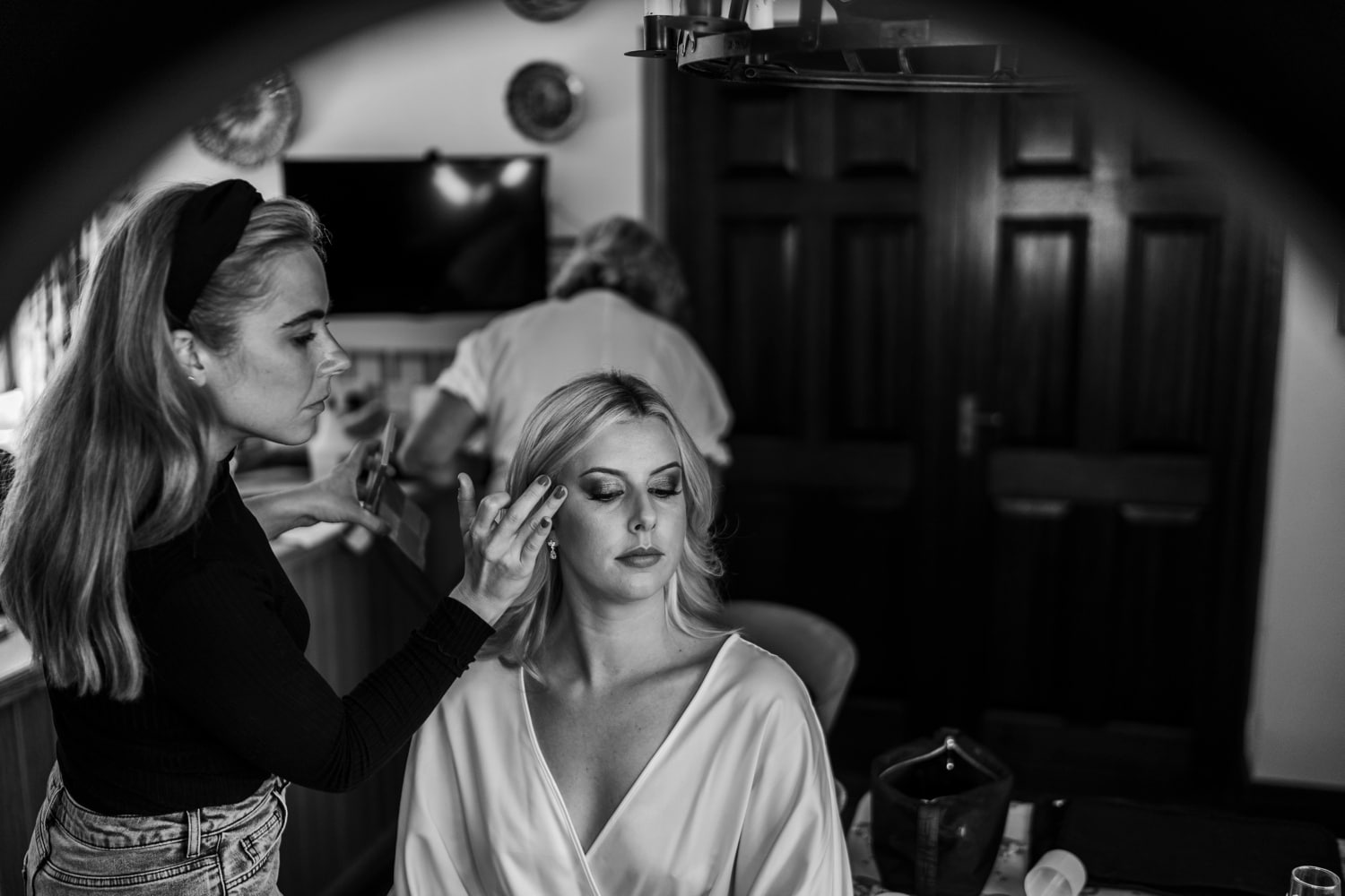South Wales bride having make up put on