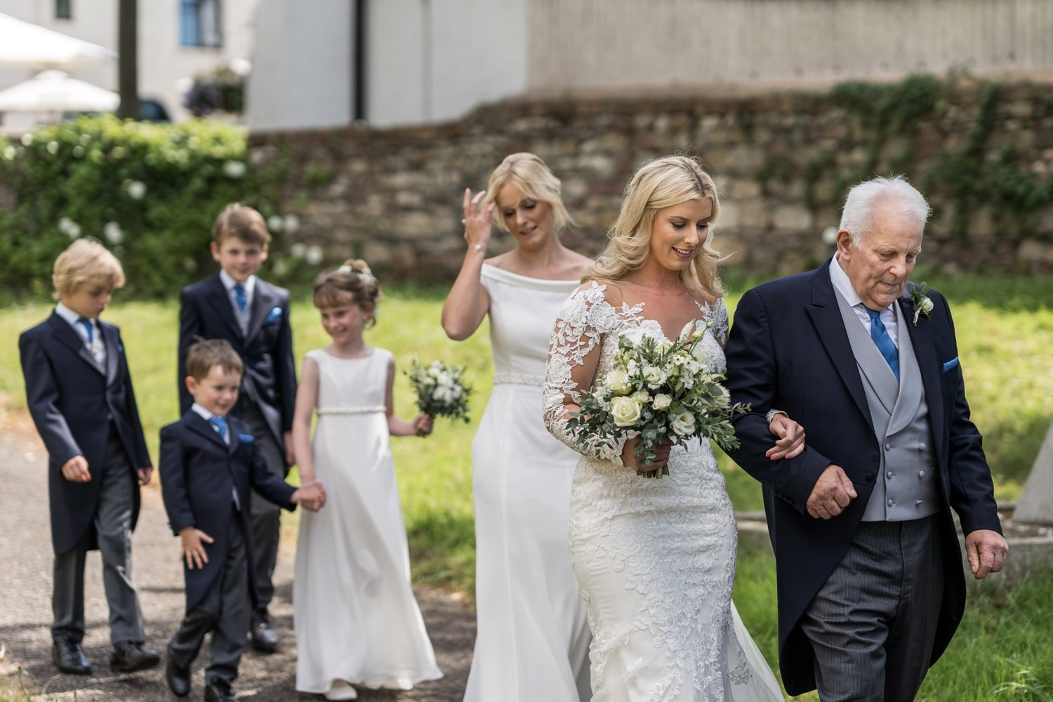 Suth Wales bride and father lead the wedding party to the church