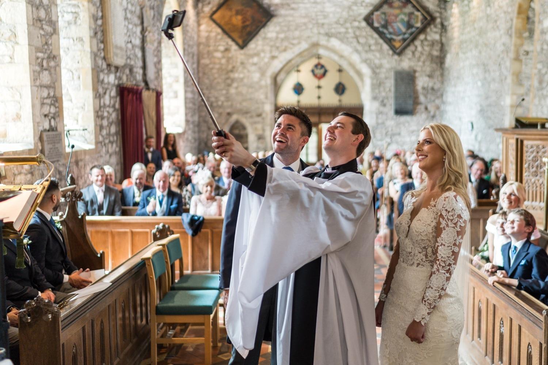 Vicar takes selfie with bride and groom